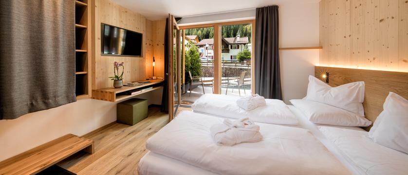 italy_dolomites_selva_mountain-design-hotel-eden_classic-deluxe-bedroom.jpg
